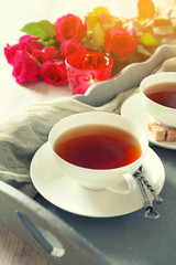 Romantic morning tea for two with candles and red roses