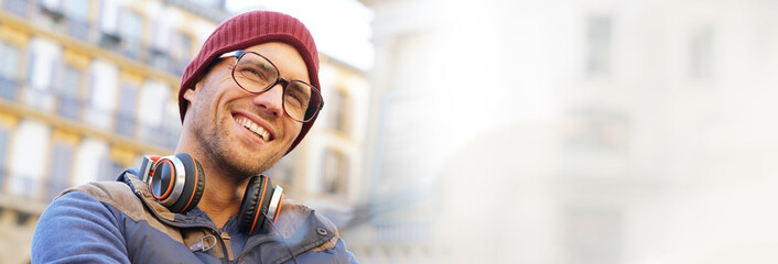 Portrait of hipster guy relaxing in town, template