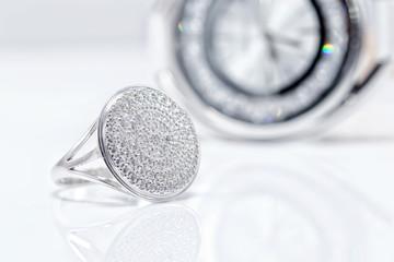 Silver ring on a background of stylish women's wrist watch