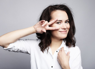 young lovely woman showing victory or peace sign