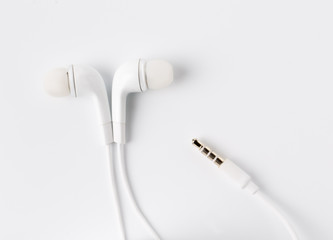 White earbuds with socket isolated on  background