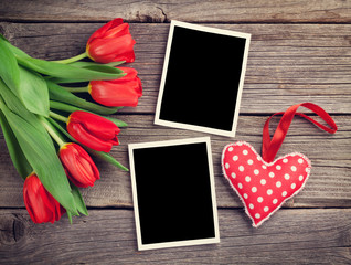Red tulips, blank photo frames and heart