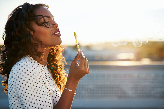 Attractive woman blowing bubbles