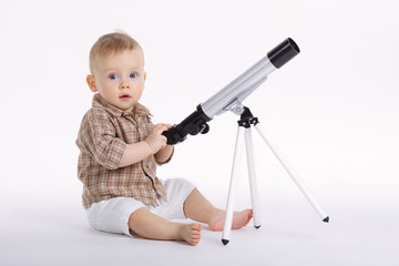 little boy with telescope exploring stars