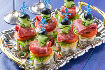 Canape on skewers with vegetables and sausage