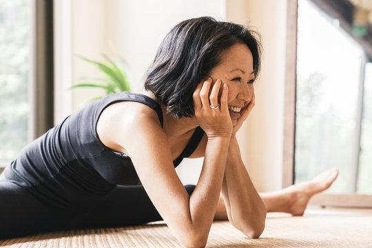 Flexible woman practicing yoga