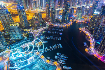 DUBAI, UNITED ARAB EMIRATES - FEBRUARY 29, 2016: View on night highlighted luxury Dubai Marina skyscrapers,bay and promenade in Dubai,United Arab Emirates
