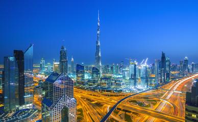 DUBAI ,UNITED ARAB EMIRATES-MARCH 5, 2016: Dubai skyline at sunset with beautiful city center lights and Sheikh Zayed road traffic,Dubai,United Arab Emirates