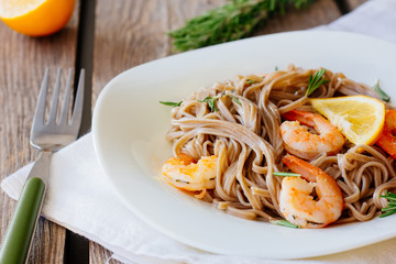 Soba noodles with roasted shrimps on dish