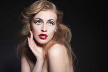 Beauty blonde woman portrait with creative pop art make up like