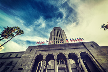 Los Angeles city hall under a dramatic sky