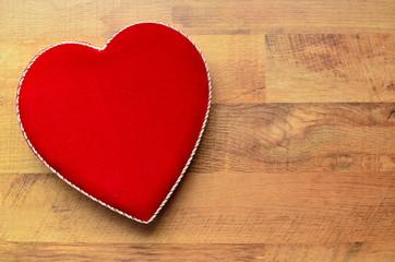 Velvet heart shaped box on a wooden background