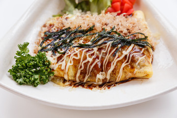 Japanese Omelette with Okonomiyaki Sauce Topping with Katsuobushi (dried, fermented, and smoked skipjack tuna), Seaweed and Mayonaise.