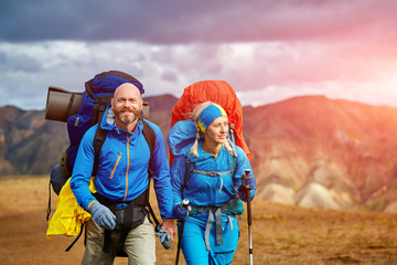 hikers on the trail in the Islandic mountains. Trek in National Park Landmannalaugar, Iceland Wall mural