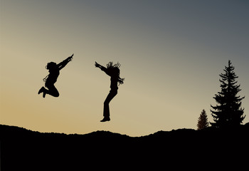 Silhouette of two  jumping girls with long hair on the wilderness. Sunset.