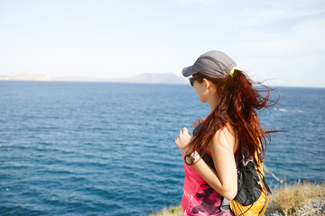 Girl on mountain overlooking sea