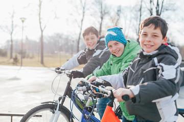 Boys riding bikes in the skate park