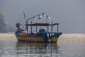 Fishing boat anchored near sandy shallow, Langkawi