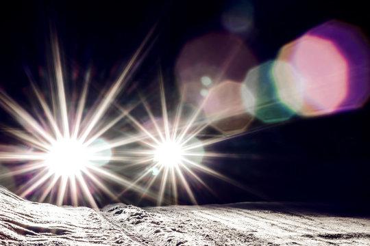car headlights shine at night