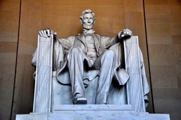Washington, DC - April 10, 2014:  Daniel Chester French's sculpture of a seated President Abraham Lincoln inside the Lincoln Memorial Wall mural