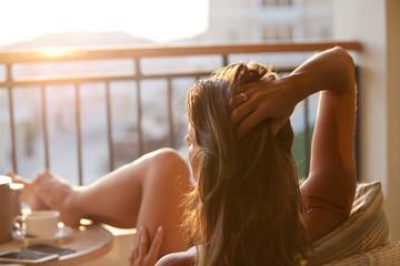 Woman relaxing enjoying sunrise.