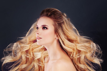 Beautiful Blonde Hair Woman with Permed Curly Hairstyle and Make