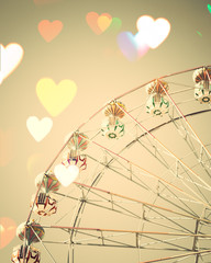 Vintage ferris wheel with heart shaped overlay
