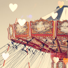 Vintage chain swing ride with heart overlay