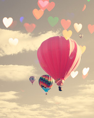 Vintage hot air balloon with heart shaped overlay