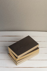 Old Books Background. Books on wooden shelf. Copy space. Vintage style toned