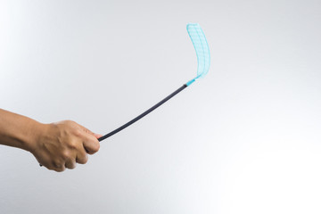 hand holding fly or insect swatter