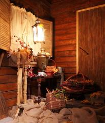Samovar with a cup of tea. / Cup of tea and a Russian samovar under the light of a lantern. Autumn.