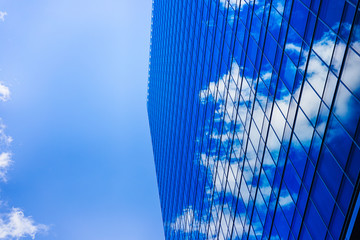 The wall of an urban building shows a blue sky