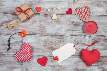 Valentine's Day background with red hearts on wooden table
