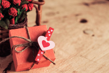 Heart-shaped and gift on wooden.