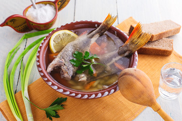 Russian fish soup on rustic background