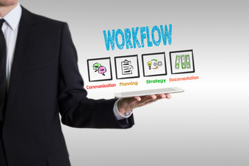 Workflow concept, young man holding a tablet computer