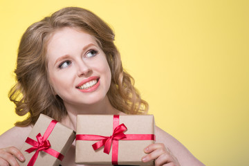 beautiful young woman with a large gift i