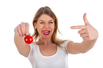 Funny woman holding cherry tomato