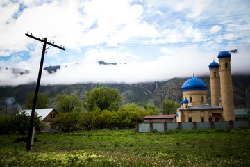 Mosque near the mountains and beautiful cloudly sky, Kazakhstan