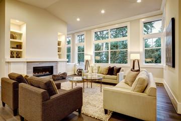 Chic light living room design with dark floors.