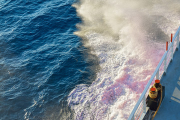 Ferry breaking waves on the sea