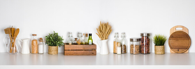 Canvas Prints Spices Kitchen shelf with various herbs, spices, utensils on white background