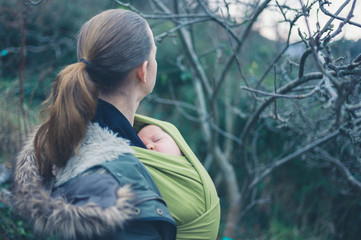 Woman with baby in nature