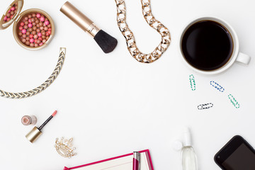 Cup of black coffee, telephone, diary and cosmetic makeup and accessories