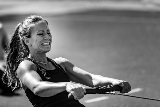 Woman on rowing machine on competition