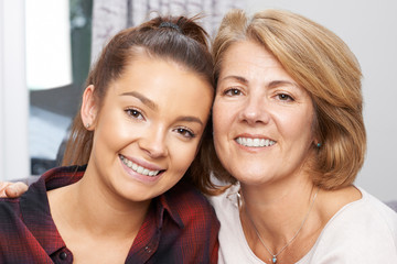 Portrait Of Mature Mother With Teenage Daughter