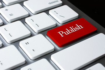 Publish on Red Enter Button on white keyboard