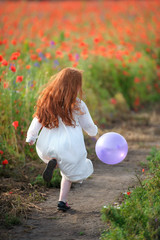 kid girl running away with balloon in hand - outdoors