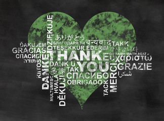 thank you, thanks in different languages, word cloud on backboard with green heart